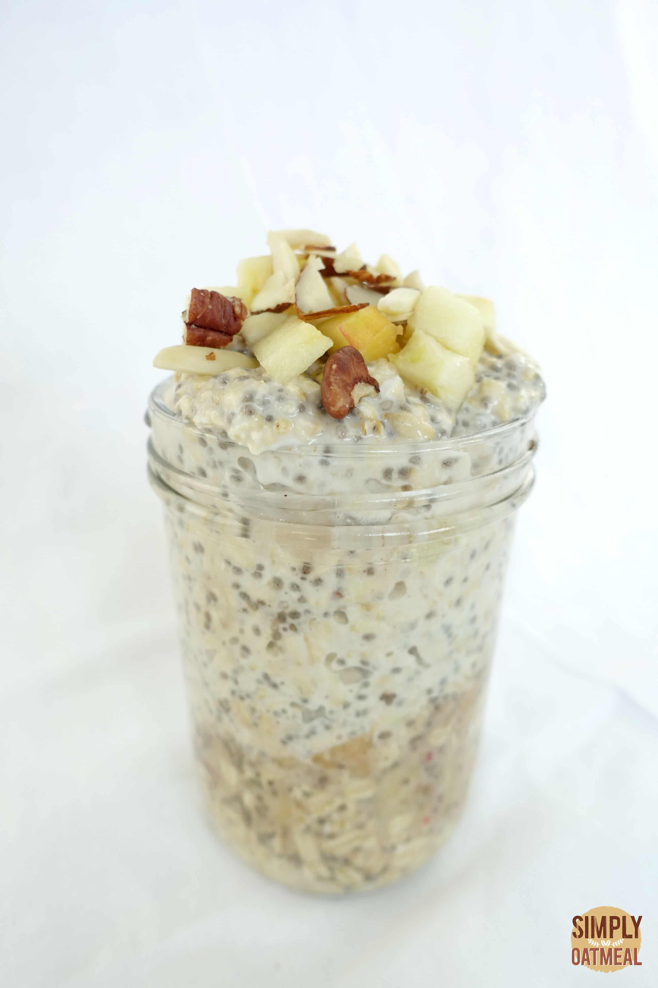 Single serving of apple chia overnight oats in a glass container.