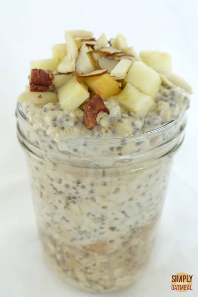 One serving of apple chia overnight oats in a tall mason jar.