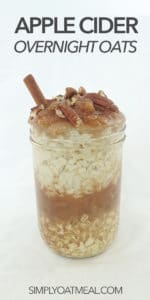 A glass container filled with apple cider overnight oats.