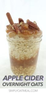 Mason jar filled with apple cider overnight oats. Topped with applesauce and chopped pecans.