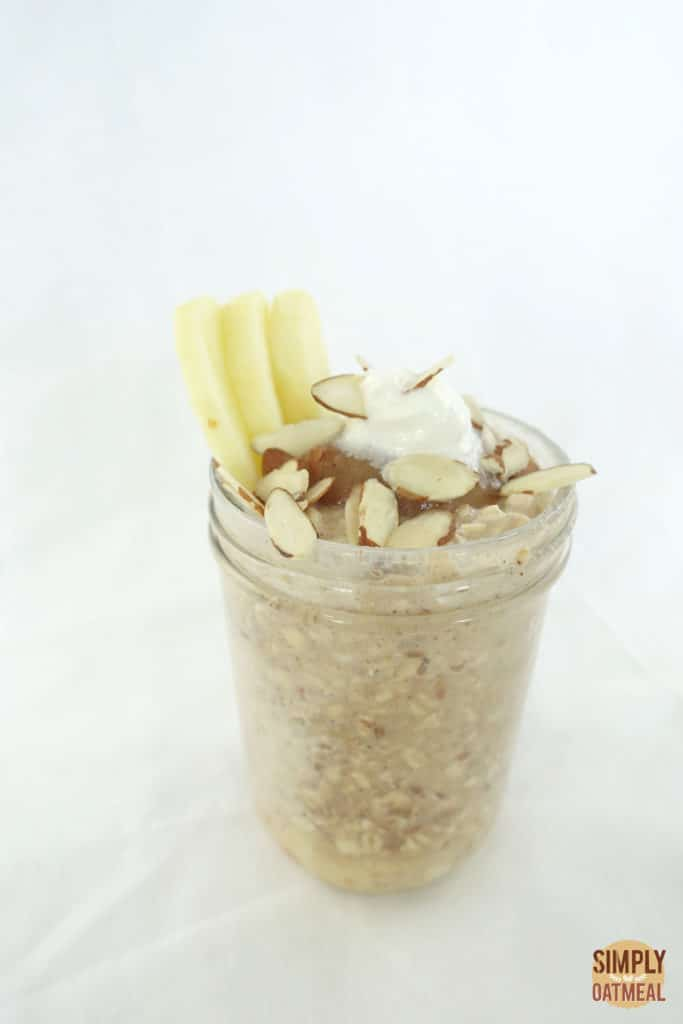 One serving of apple cinnamon overnight oats in a glass container.