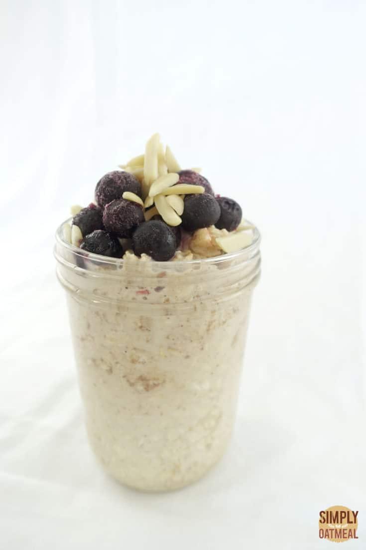 Single serving of apple juice overnight oats in a mason jar.