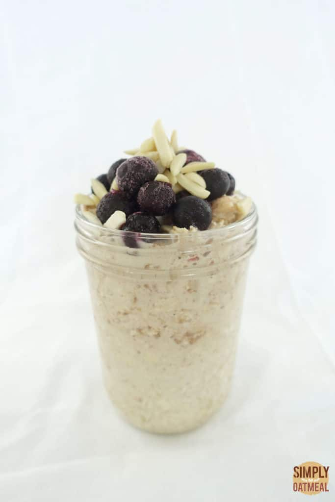 One serving of apple juice overnight oats in a glass container.