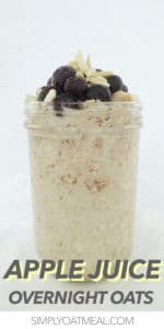Apple juice overnight oats served in a tall mason jar and topped with blueberries and slivered almonds.
