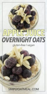 Blueberries and slivered almonds on top of apple juice overnight oats in a glass bowl.