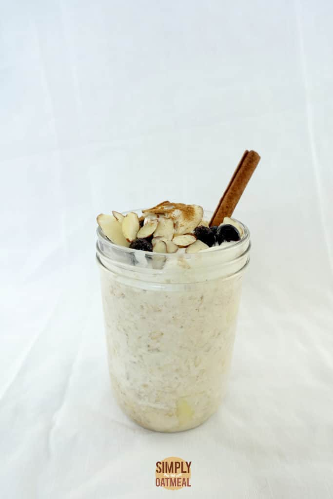 One serving of apple pie overnight oats filled to the brim in a mason jar.