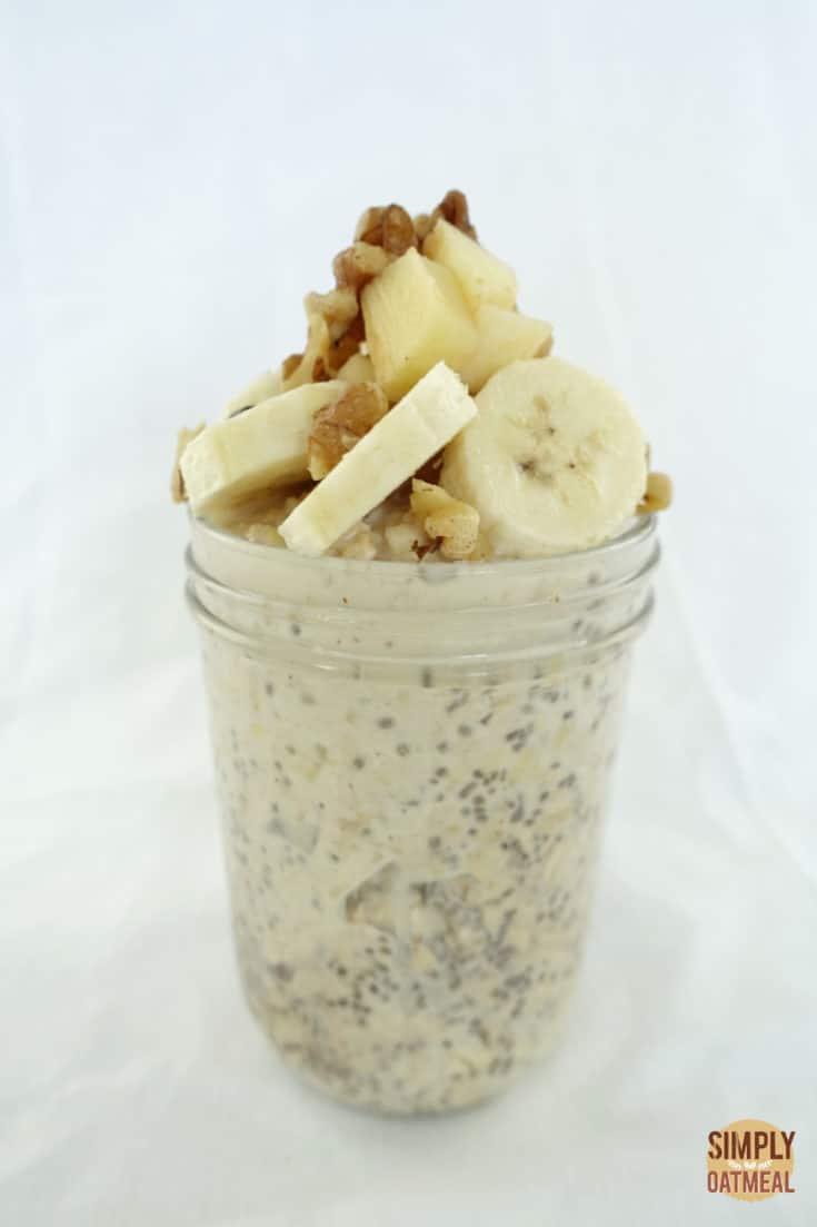 A single serving of apple walnut overnight oats in a mason jar.