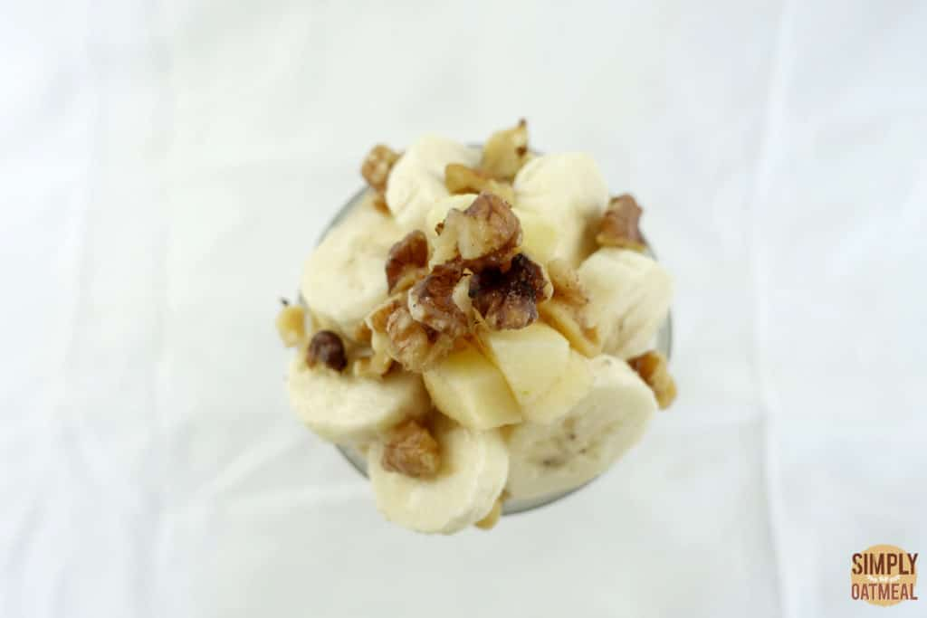 Sliced banana, diced fresh apple and chopped walnuts on top of overnight oatmeal.