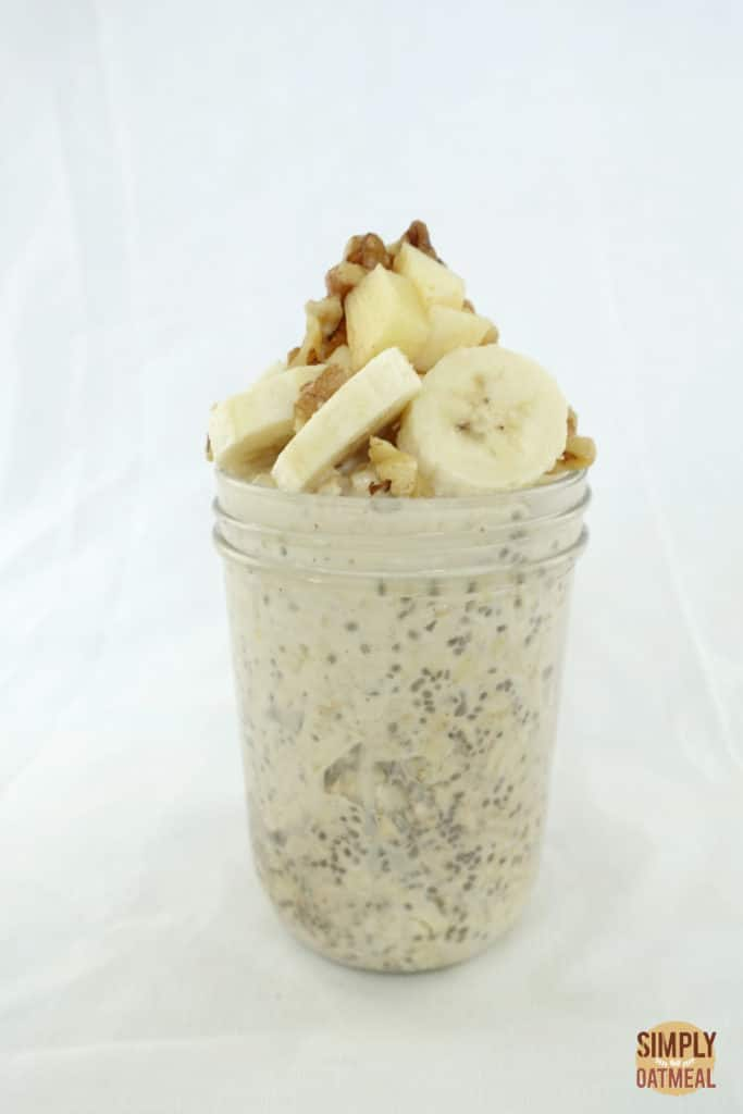 One serving of apple walnut overnight oats in a glass container.