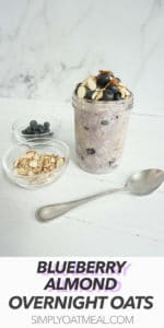 Glass container with one serving of blueberry almond overnight oats. The garnishes include almonds and fresh blueberries.