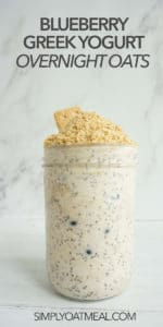 Blueberry Greek yogurt overnight oats look creamy and delicious in a glass container.