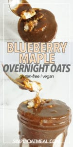 blueberry maple overnight oats in a glass bowl topped with dark maple syrup.