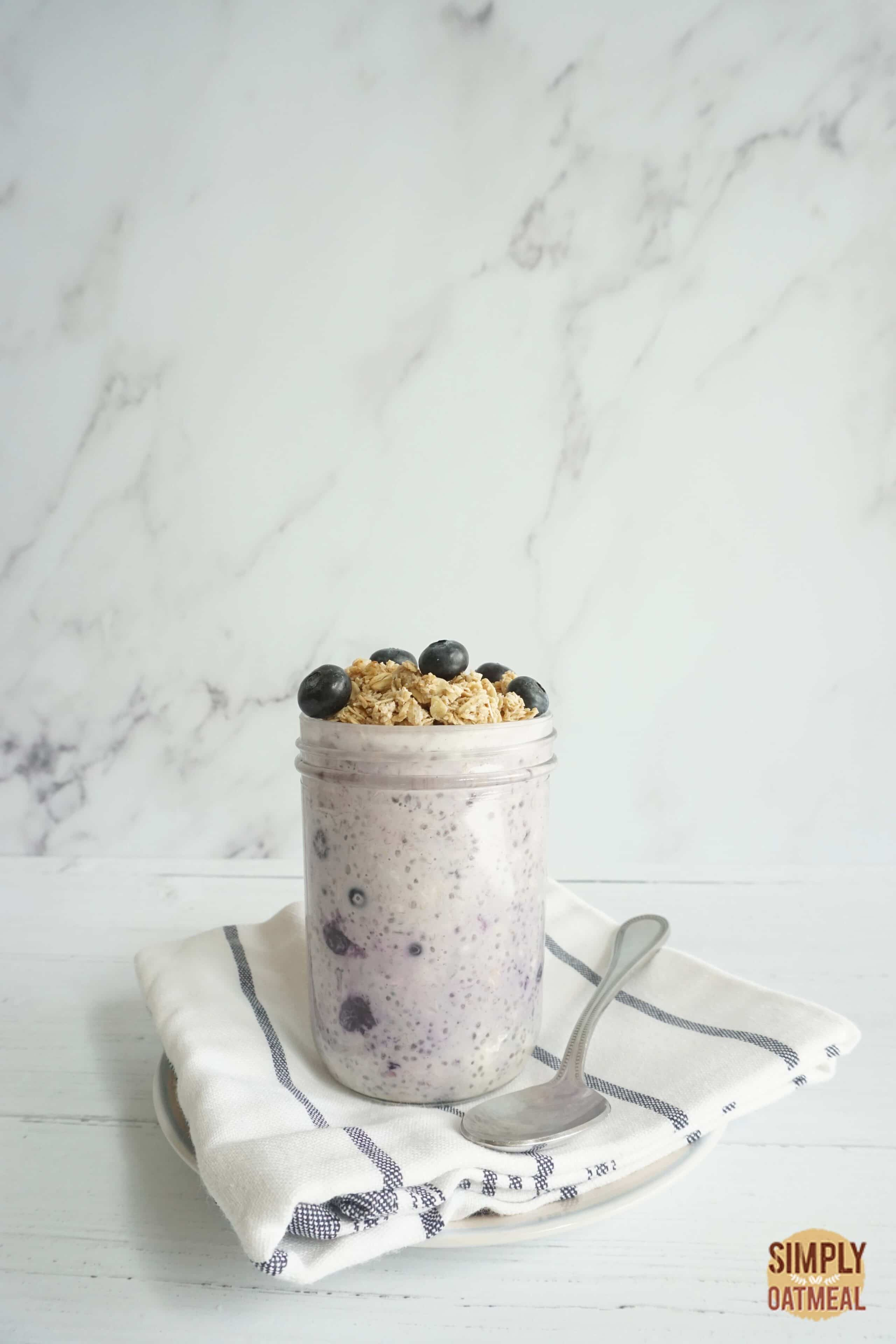 Single serving of blueberry pie overnight oats in a mason jar.