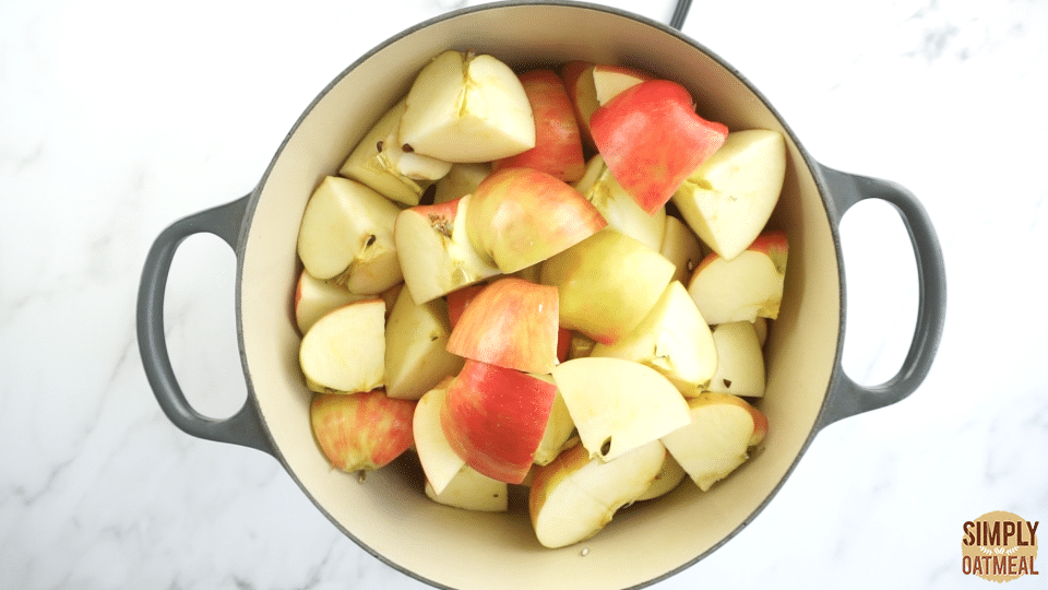 Chopped apples inside a large dutch oven prepared to start cooking this easy apple butter recipe