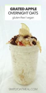 Grated apple piled high on top of soaked overnight oats in a glass container.