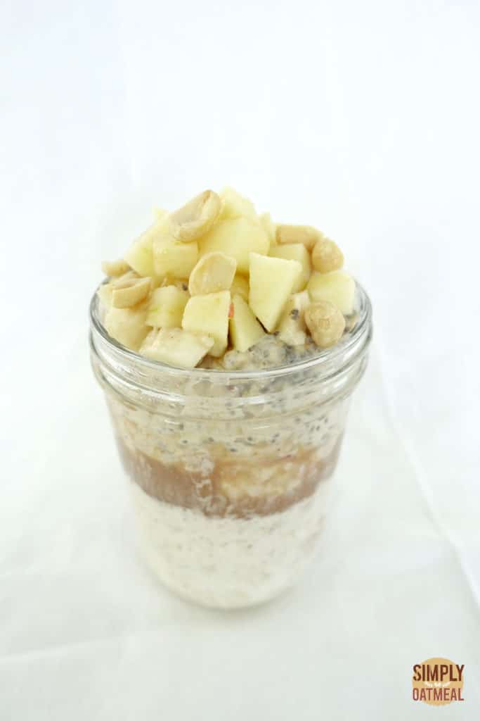 Peanut butter and overnight oats layered in a mason jar.