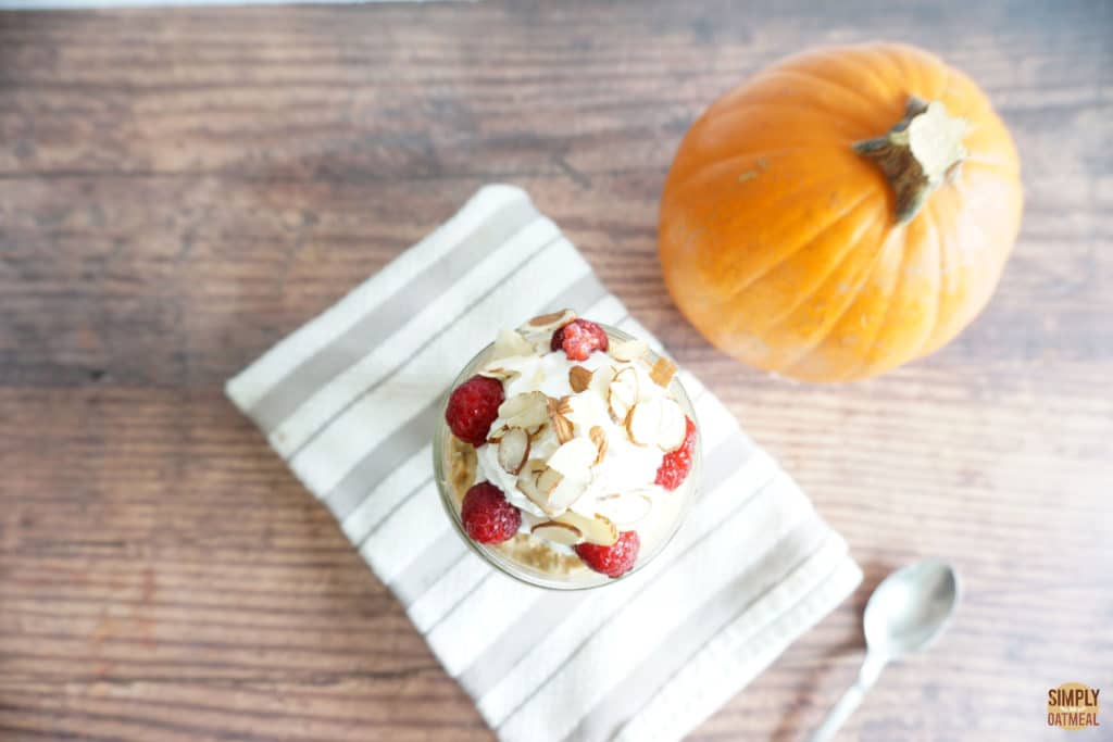 Pumpkin cheesecake overnight oats in a small glass bowl.