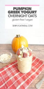 pumpkin greek yogurt overnight oats with whipped cream, strawberries and sliced almonds on top.