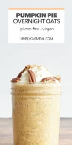 pumpkin pie overnight oats in a glass jar topped with whipped cream, pecans and a sprinkle of cinnamon