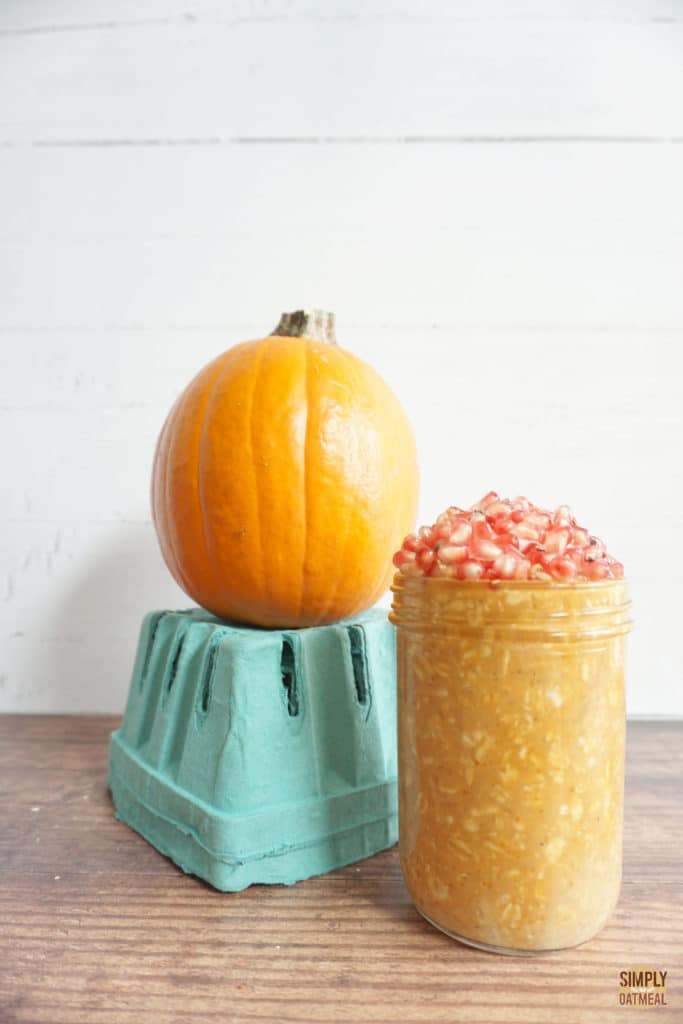pumpkin puree overnight oats served in a mason jar with a small pie pumpkin on the side