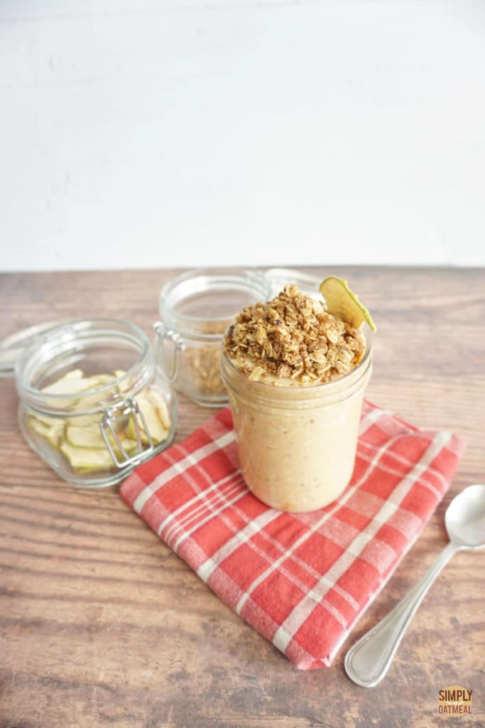 pumpkin spice overnight oats topped with crunchy granola and dried apple chips