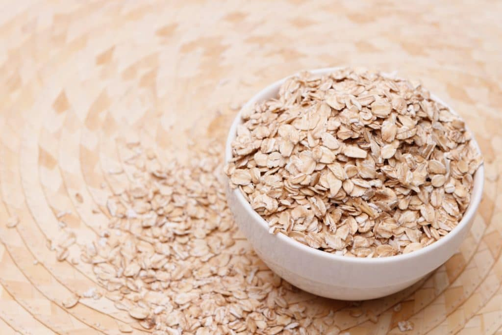 Rolled oats in a white bowl