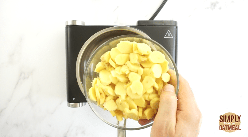 Slice fresh ginger to even thickness using a mandoline
