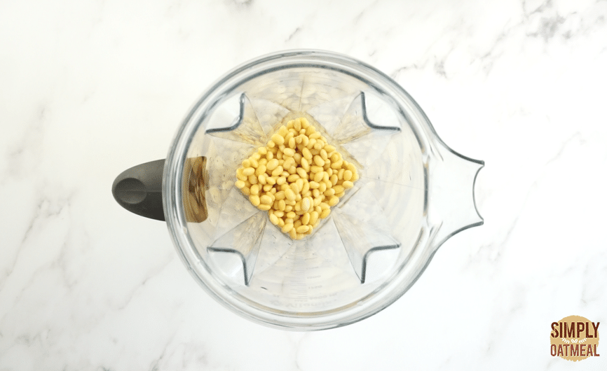 Soybeans are soaked in water overnight and then placed in a blender.