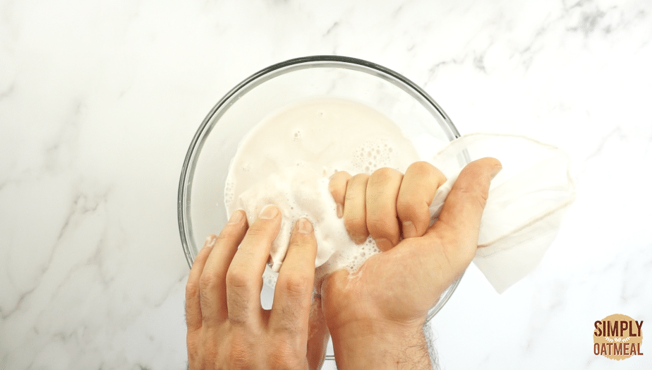 Squeeze the nut milk bag to press out as much almond milk as possible.
