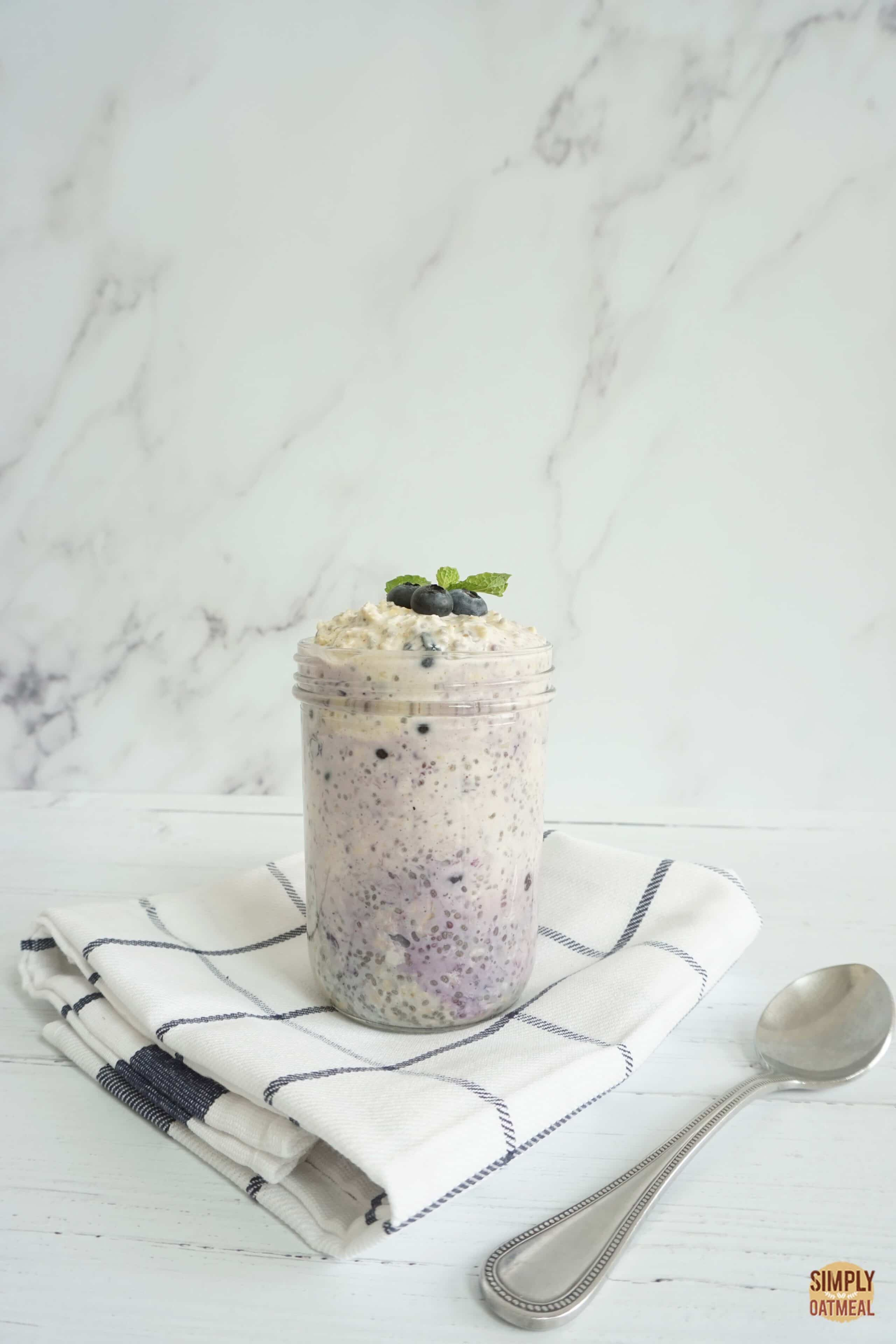 Mason jar filled with single serving of vegan blueberry overnight oats