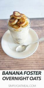 One serving of banana foster overnight oats with a spoon on the side.