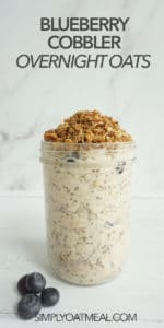 Glass container with one serving of blueberry cobbler overnight oats. The container is full and oven baked cobble topping decorates the top.