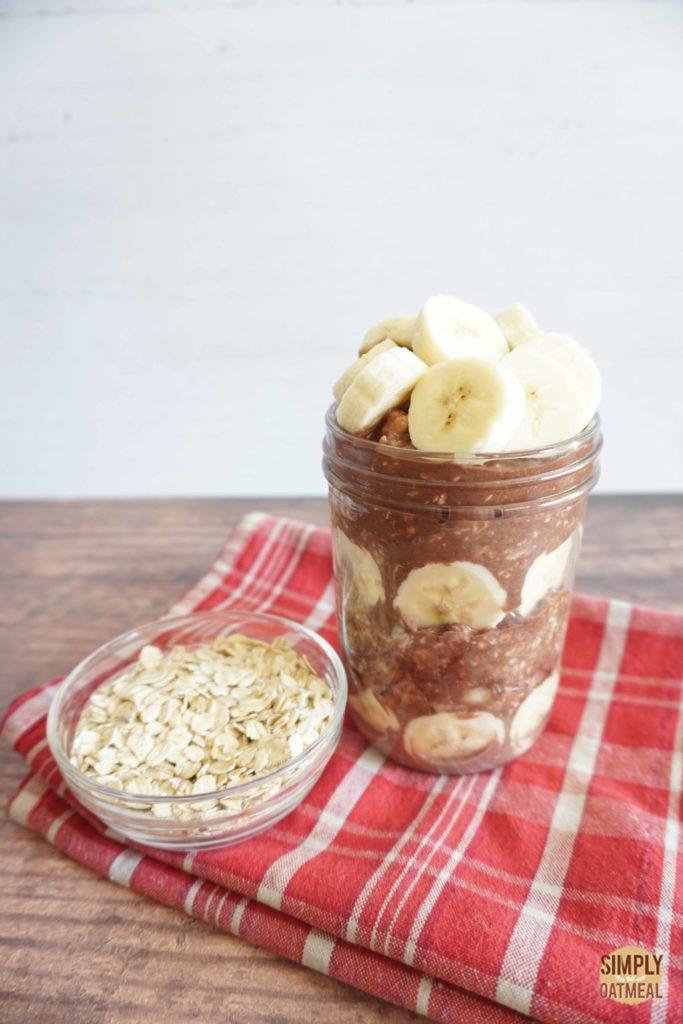 Chocolate banana overnight oats served in a mason jar.