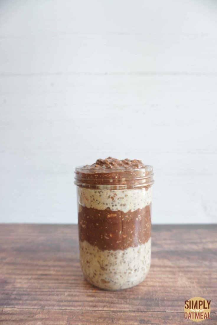 Single serving of chocolate peanut butter banana overnight oats in a mason jar.