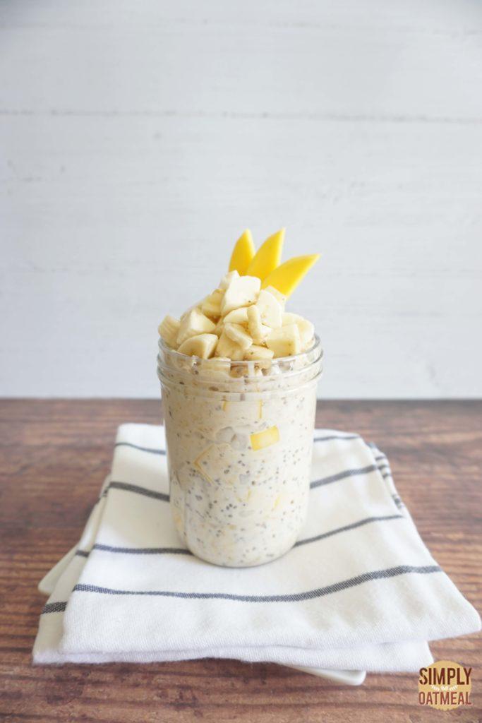 Single serving of mango banana overnight oats in a mason jar