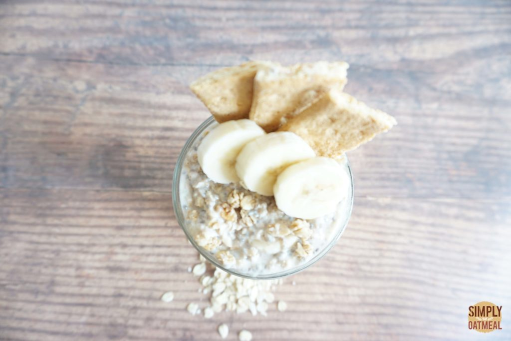 Mashed banana overnight oats topped with graham crackers and sliced banana.