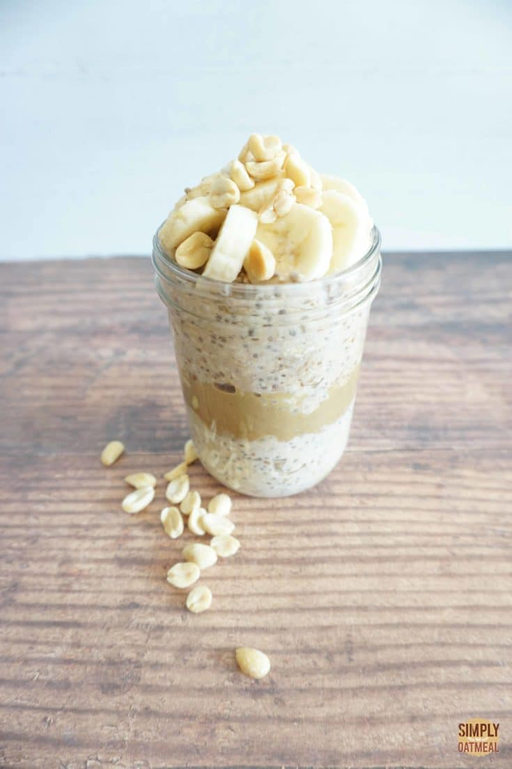 Overnight oats layered with peanut butter and sliced banana on top.