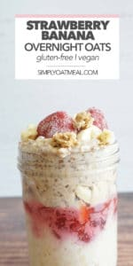 Closeup of strawberry banana overnight oats in a glass bowl with fresh strawberries and banana slices