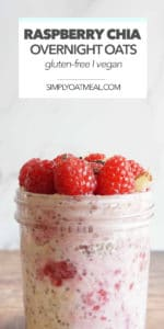 Fresh raspberries and crunchy granola on top of raspberry chia overnight oats in a glass jar