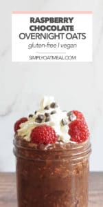 Glass bowl of raspberry chocolate overnight oats topped with whipped cream, fresh raspberries and mini chocolate chips