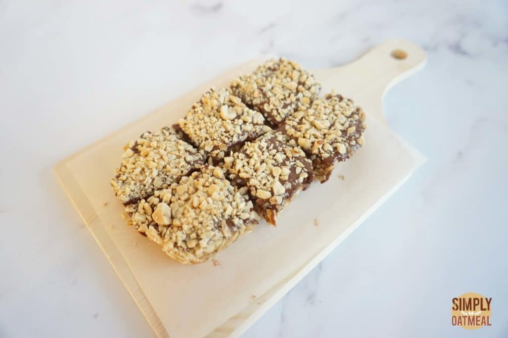 Closeup of the no bake chocolate peanut butter fudge oatmeal bars on a cutting board