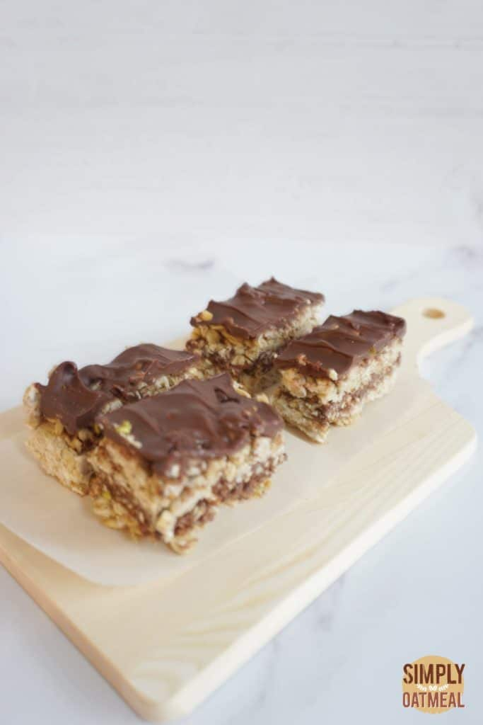No bake chocolate pretzel oatmeal bars on a wooden cutting board