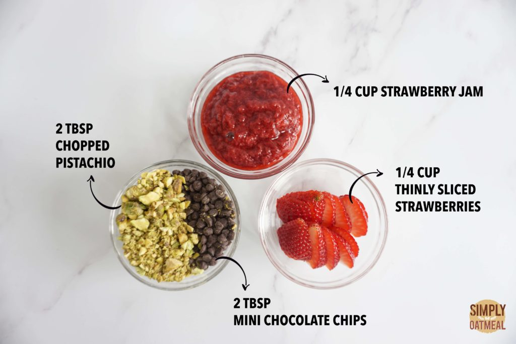 Pistachio, mini chocolate chip and strawberry toppings for the no bake strawberry oatmeal bars
