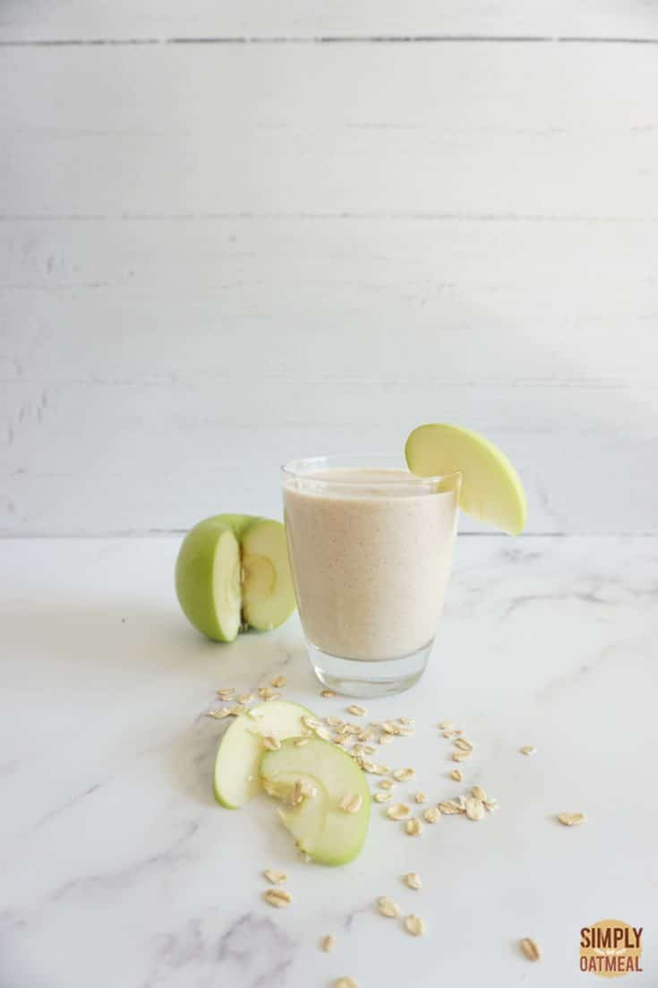 Serving of apple pie oatmeal smoothie in a glass cup