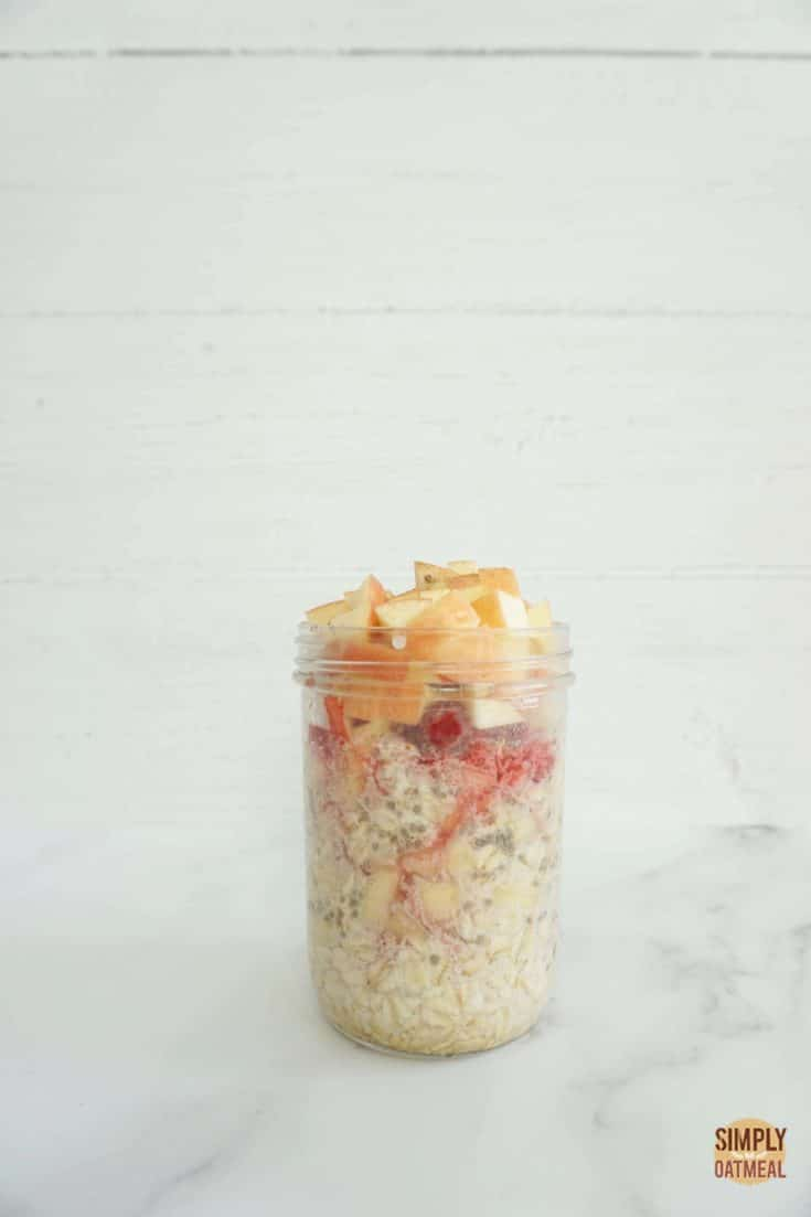 One serving of apple raspberry overnight oats in a glass jar
