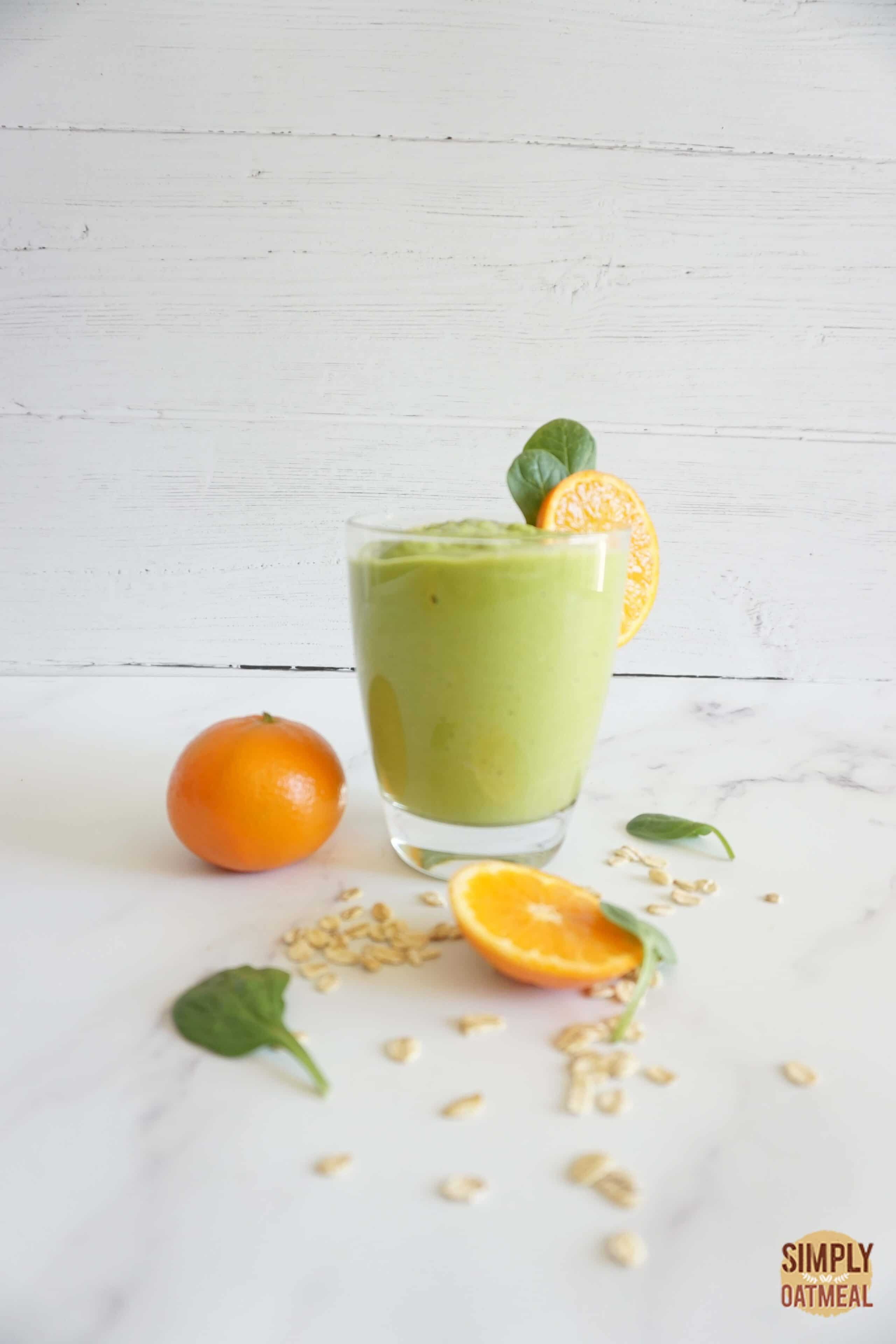 Single serving of avocado dreamsicle oatmeal smoothie in a glass cup.