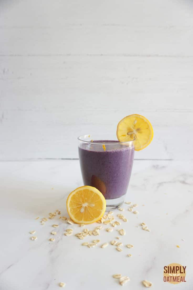 Single serving of blueberry lemon oatmeal smoothie in a glass cup