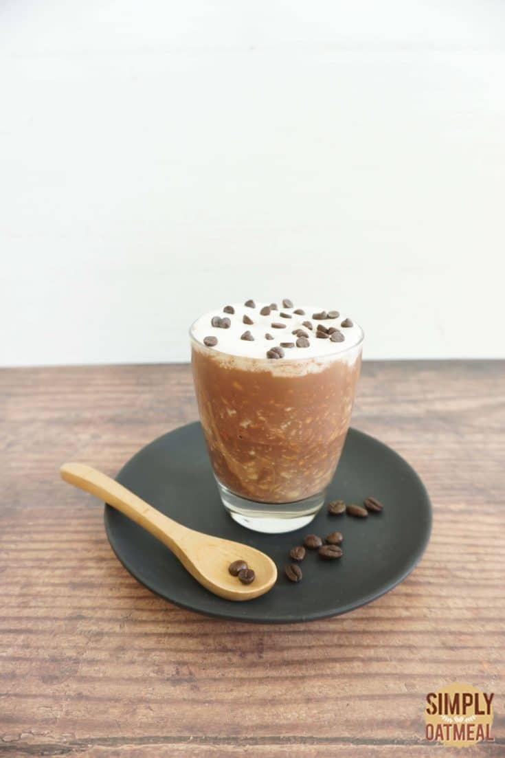 Single serving of caffe mocha overnight oats in a glass cup.