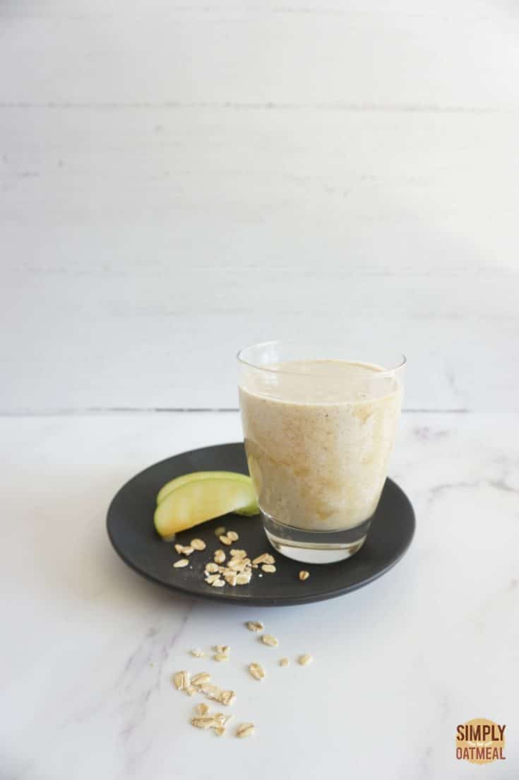 Single serving of caramel apple oatmeal smoothie in a glass cup