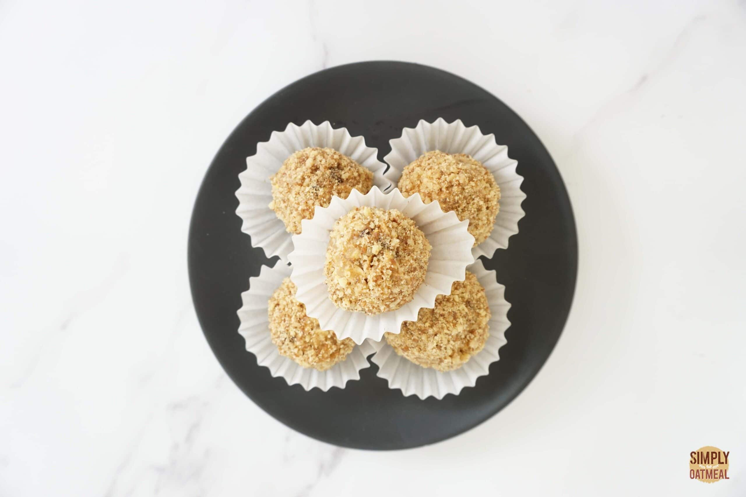 5 no bake banana walnut oatmeal balls in small paper cups